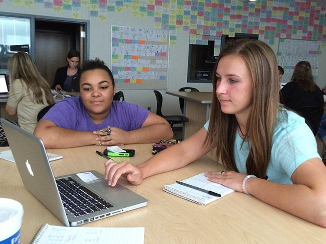 Senior Morgan Knobloch and junior Maurisha Murphy work on the Cat's Claw website at a summer work shop in Frisco. The staff plans to have the Cat's Claw on social media soon as well.
