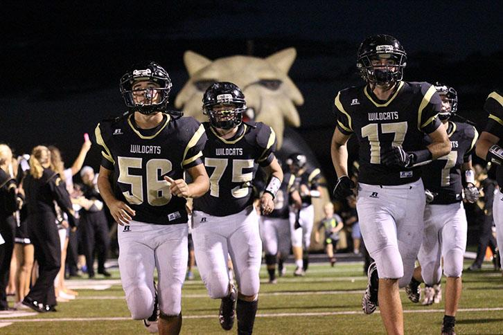 Players Keaton Coleman, Dalton Drennan and Jarrod Richey race onto the field after half-time.