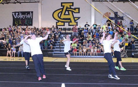 Junior Erin McGregor, sophomores Grace Morris and Sierra Mooney and junior Bailey Rice lead the group in their performance. Photo by Maurisha Murphy