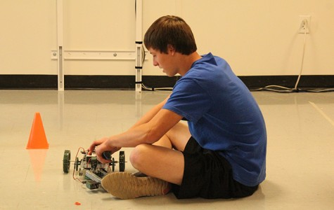 Junior Jeremiah Cooke works on his robot as the class experiments with their inventions.