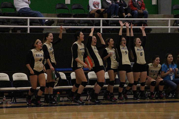 Players cheer as their teammates get a block.