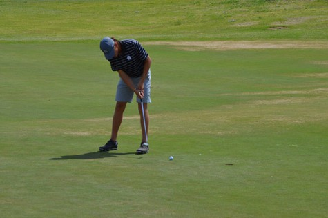 Sophomore Morgan Wylie putts at the regional tourney in Ferris.