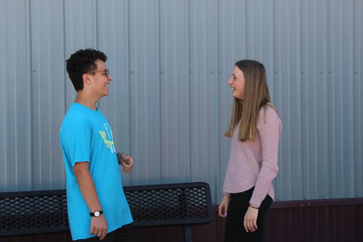 Foreign exchange students Jorge Moral Vidal and Fjonna Ramin converse outside of the portable buildings.
