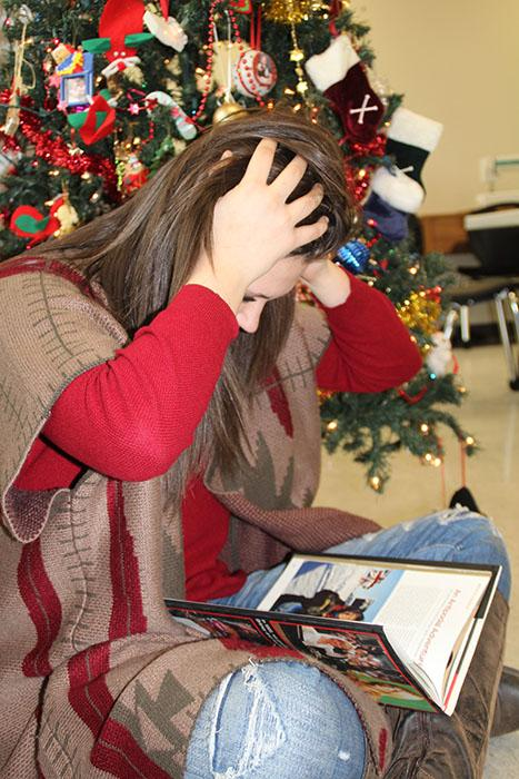 Freshman Shaylee Watson stresses over juggling her studies with holiday events.