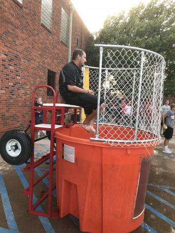 Coach Andrew Morris sits in the dunk tank awaiting the dunk of doom.