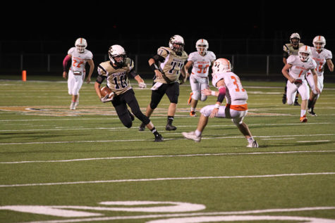Freshman Jed Castles avoids a tackle in the game against Petrolia