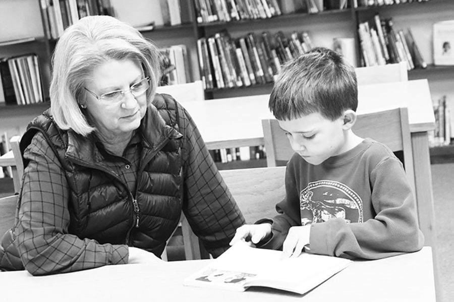 Volunteer Jean Ashton listens to second grader Timothy Bracey read. Mrs. Ashton participates in the Book Buddy program, which provides reading partners for students.