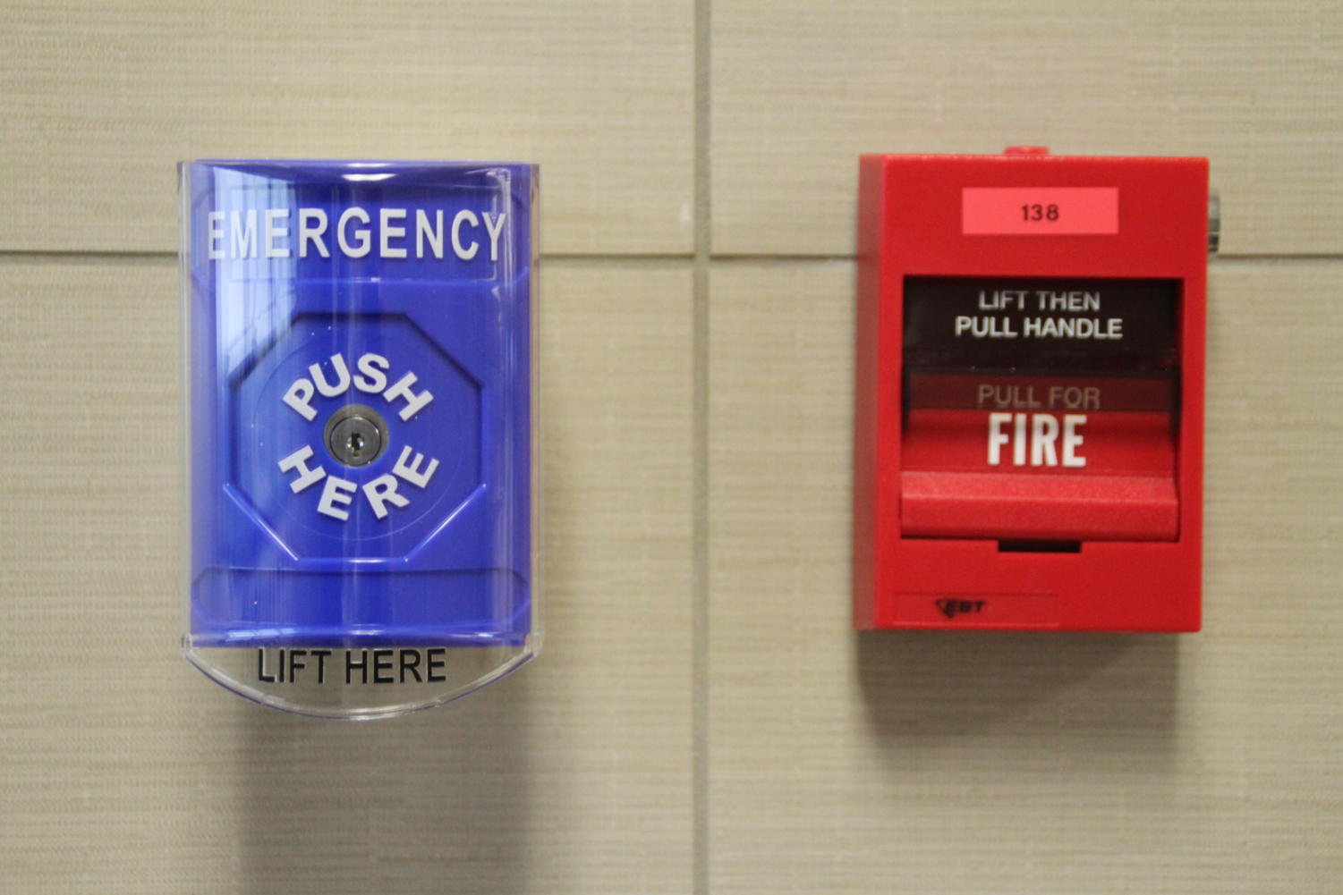 The new blue security buttons are located next to the existing fire alarms.
