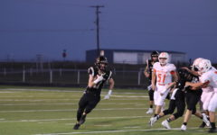 Senior Conner Byrd runs the ball in the Wildcats 62-7 win over Petrolia