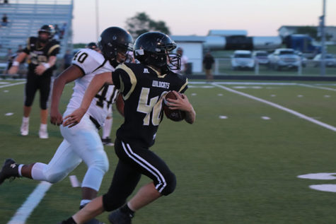 Hunter Sims runs the ball against Haskell