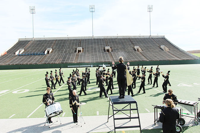 Senior+drum+major+Audrey+Schroeder+leads+the+Prowlin%27+Growlin%27+Wildcat+Band+during+the+region+marching+contest+on+Saturday.+The+band+received+an+%27excellent%27+rating.