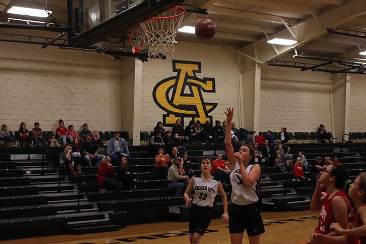 eighth grader grader Faith Morris shoots the ball