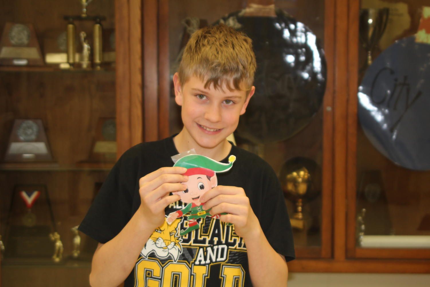 Seventh grader Jesse Pulley shows off Buddy the Elf that he found the first week of the Student Council game.