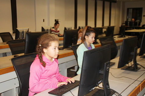 Sixth graders Jayda Bogar and Adelyn Harvey compete in the district editorial writing contest.