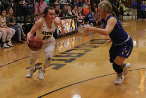 Freshman Aspyn Huseman dribbles past Windthorst defender.