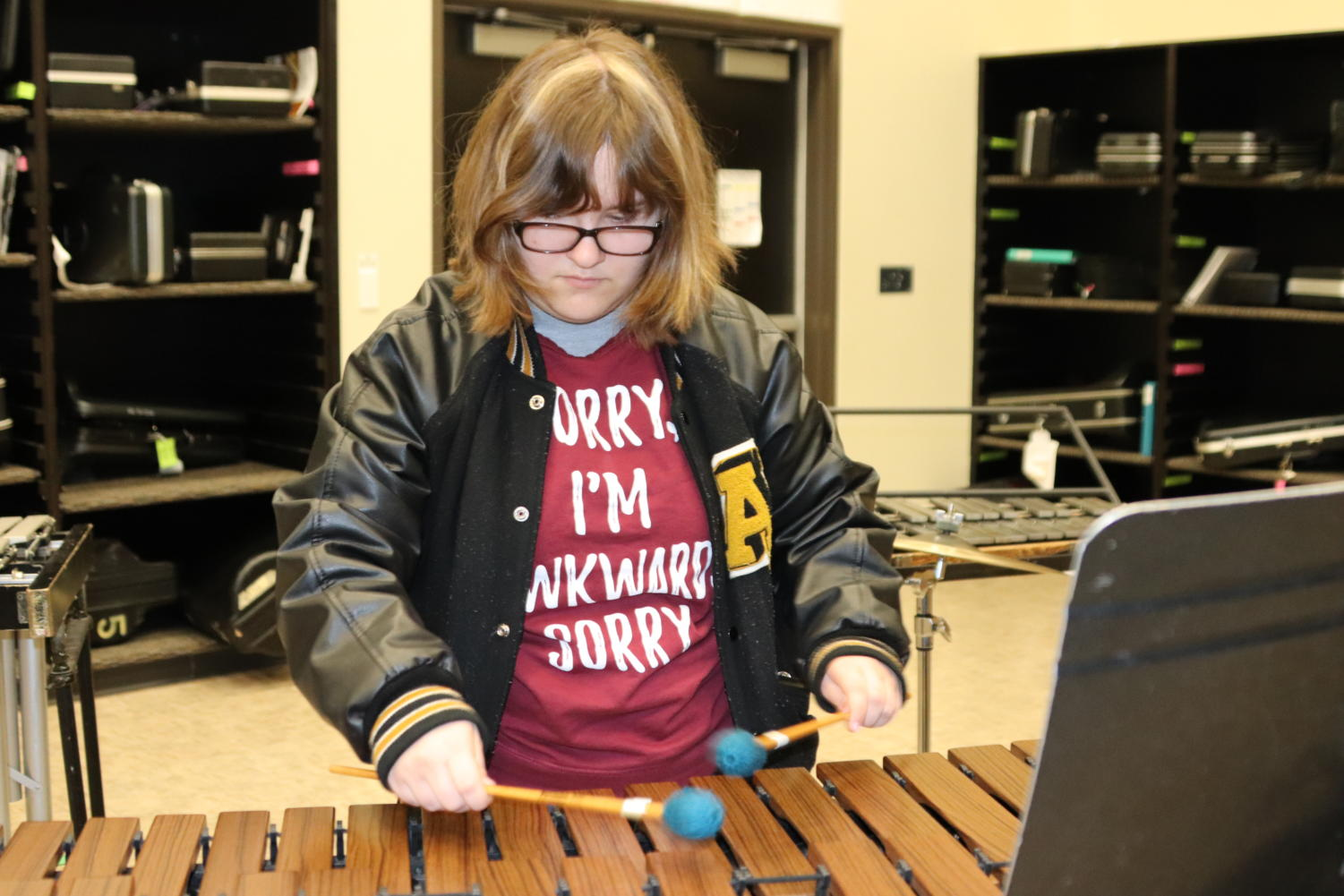 Senior Emily Richardson plays the marimba in the band hall. She is thinking about a career in music.