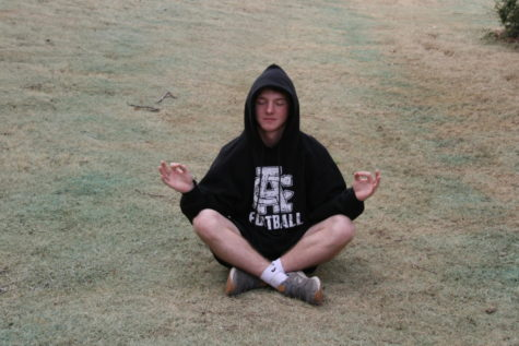 "Sophomore Jaxton Barrett meditates his stress away. He said mediation ""has a magical way of relieving stress."""