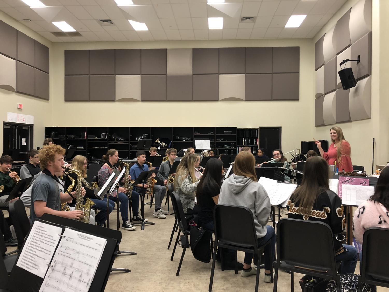 The PGWB warms up with their daily routine before rehearsing the three pieces of music. They'll be taking them to the UIL contest in April.