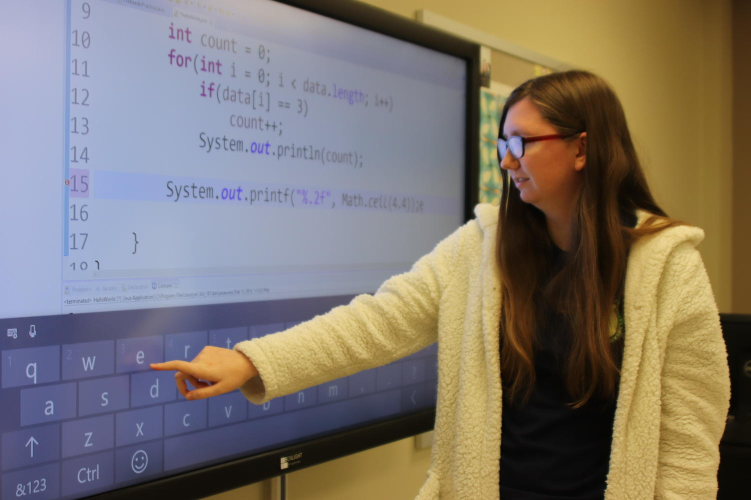 Senior Ally Warren in the code for a computer program. Ally advanced to state last year in computer science.