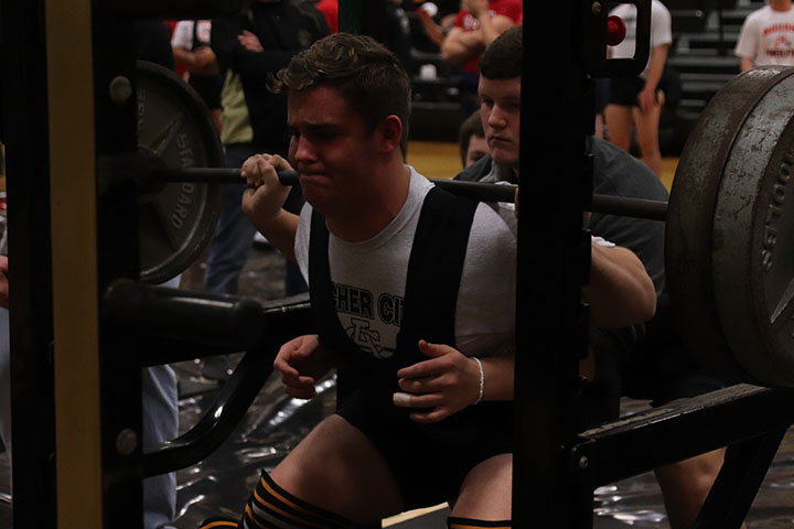 Chase Stafford squats at the Archer City powerlifting meet. He placed first in his weight division.