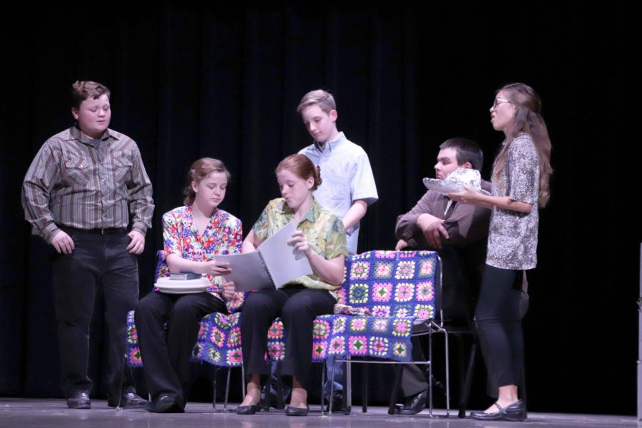 Eighth graders Bonner Hand, Leiah Graham, Justine Neely, Chase Curry, Dylan Hall and Kassidy Marin perform a scene from
