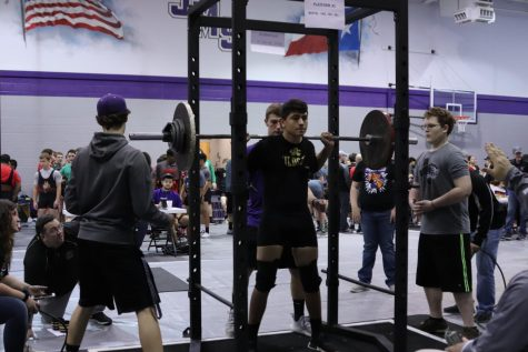 Freshman Christopher Allen prepares to squat during the meet.