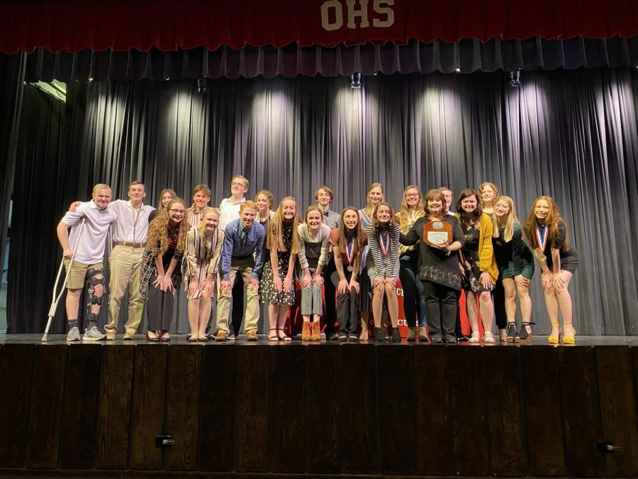 The OAP cast and crew accept their plaque to advance