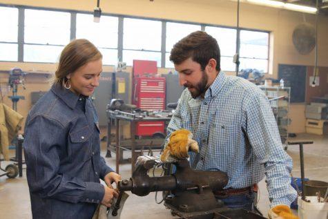FFA Sponsor Tyler Moore helping sophomore Faith Morris.