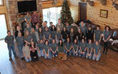 NHS members pose in the hall at V-Tex Ranch.